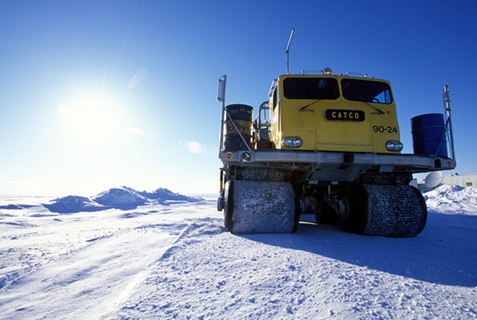 Rolligons, all-terrain vehicles that move on large, low-pressure adjustable tires, are typical of the vehicles used for transport on the North Slope, AK.