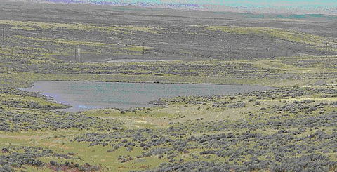 CBNG impoundment from the PRB in Wyoming located on-channel by means of a simple dam on the downgradient end of a small draw.