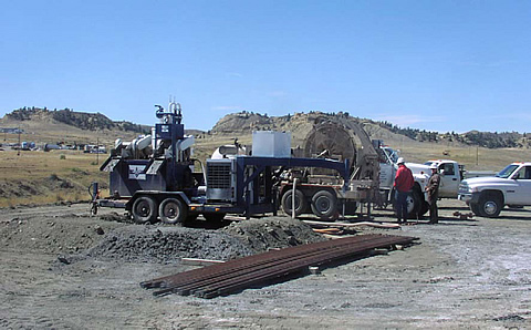 Microdrilling site at the Naval Petroleum Reserve No. 3. The Los Alamos drilling mud cleaning system (left) and coiled tubing drilling rig (right) are shown.