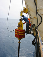 Piston core apparatus with 6-ton weight prior to being dropped Photo courtesy USGS