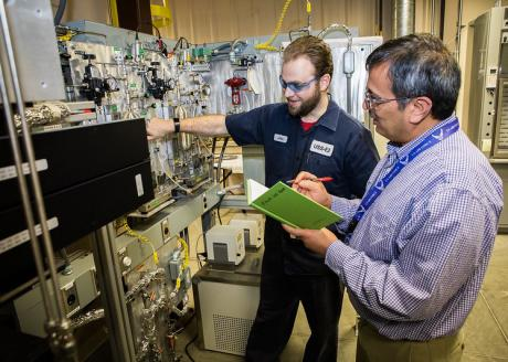 NETL researchers John Johnson and Dushyant Shekhawat operate a state-of-the-art variable frequency microwave reactor in  the Reaction Analysis and Chemical Transformation (ReACT) facility